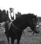 Liten Toffla på stor häst