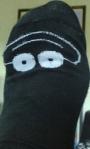 roliga strumpor svarta m ögon