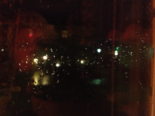 regnfönster m fotografens spegelbild